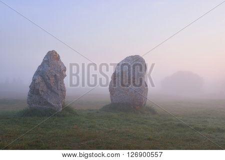 Two Menhirs At Camaret Sur Mer At Sunrise During Fog