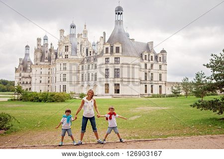 Mother And Two Children, Boys Brothers, Holding Hands In Front Of The Chambord Castle