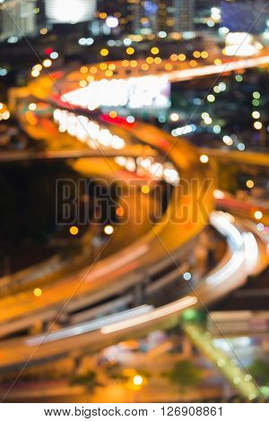 Abstract blurred bokeh lights, intersection highway night view