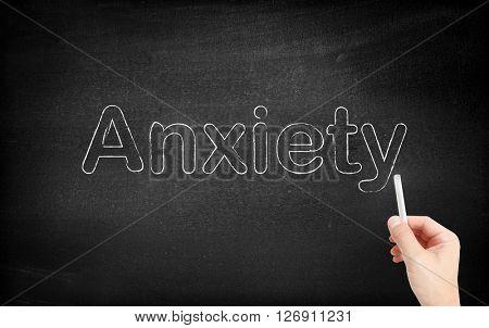 Anxiety written on white blackboard