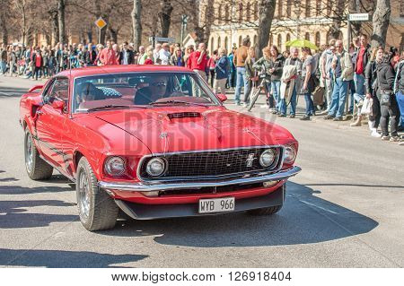 NORRKOPING, SWEDEN - MAY 1: 1969 Ford Mustang Mach 1 at classic car parade celebrates spring on May 1, 2013 in Norrkoping, Sweden. This parade is an annual tradition in Norrkoping on May Day.