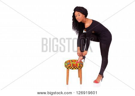 Beautiful African American Woman Putting Her High Heels Shoes