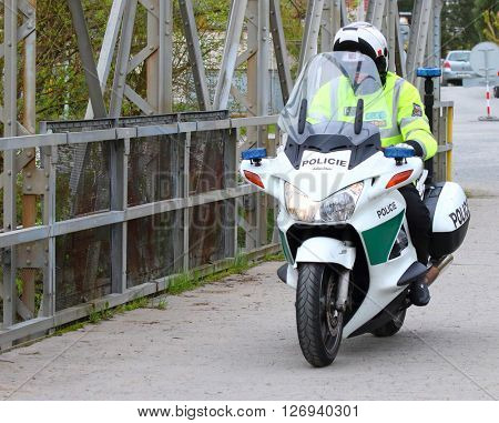 PILSEN CZECH REPUBLIC - APRIL 23, 2016: Czech policeman driving on Honda Pan European motorcycle. Liquid-cooled engine 1,261 cc, maximal speed is 225 km/h, weight 286 kg.