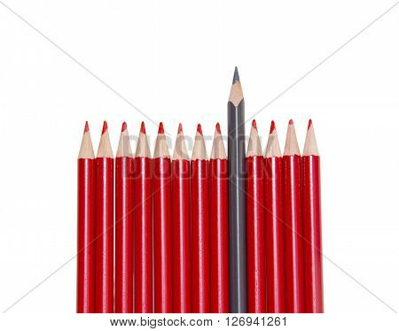 Black pencil standing out from the red pencils isolated