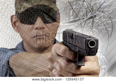 Man with Border fence barb razor wire with American Flag Concept