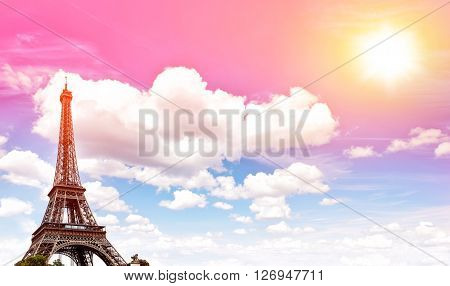 Eiffel Tower against colorful blue sunset sky. Champ de Mars Paris Europe. Vintage style toned picture
