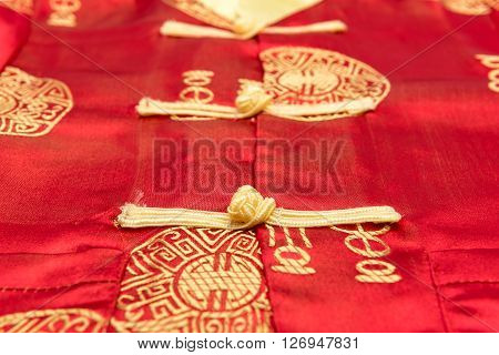 Close Up Of Chinese Boy's Traditional Clothing