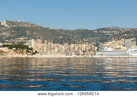 Color DSLR stock image of luxury apartment building and condominiums in Monte Carlo, Monaco, on the French Riviera. Horizontal with copy space for text