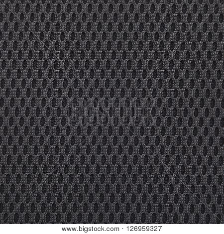 Black multilayer fiber fabric texture. Close up top view.