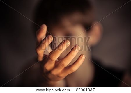 Open Hand Reaching Out From Obscured Face