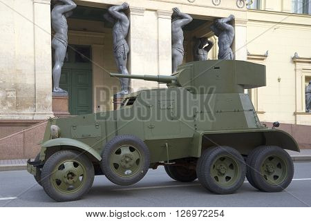 SAINT PETERSBURG, RUSSIA - MAY 05, 2015: Soviet armored car 30-ies BA-3 on the background of the New Hermitage