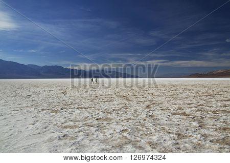 Bad Water Basine in Death Valley (California) - people on salt field