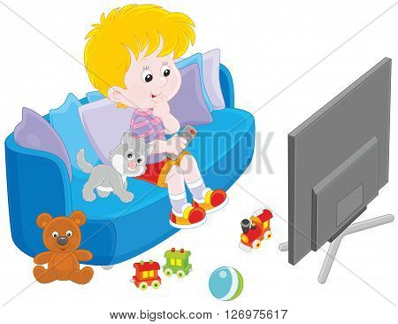 little boy sitting on the sofa and watching TV