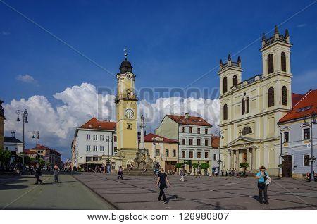 Banska Bystrica, Slovakia - May 10, 2013: Town square with Clock Tower and St Franciska church (Kostol) in Banska Bystrica.