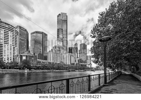 MELBOURNE - JAN 31 2016: View of Yarra river with Eureka Tower and office buildings in the background. Black and white image.