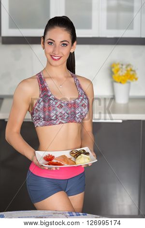 Young Fit Woman In The Kitchen, Preparing Healthy Meal