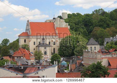KAZIMIERZ DOLNY, POLAND, JUNE 10, 2015 YEAR. Kazimierz Dolny by tne Vistula river, Poland. Fara and ruins castle.