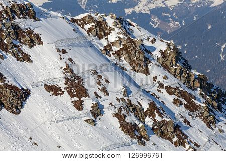 Photo of snowy mountainside with avalanche protection barriers