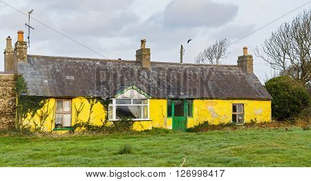 Photo of a rundown house in an irish farm