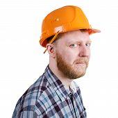 Bearded construction worker in orange construction helmet poster