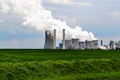lignite fired power station behind a agricultural field landscape Niederaussem Germany issued in May 2007 by the WWF as the third-worst power station in Europe in terms of the relation of energy efficiency to CO2 emissions poster