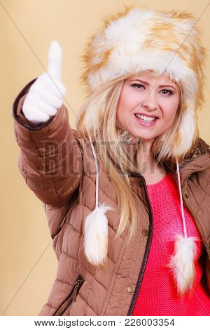 Accessories And Clothes For Cold Days, Fashion Concept. Blonde Woman In Winter Warm Furry Hat In Rus