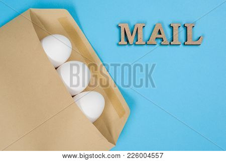 The Concept Of Secure Courier Service, Reliable Postal Company. Abstract Image Of Eggs In An Envelop