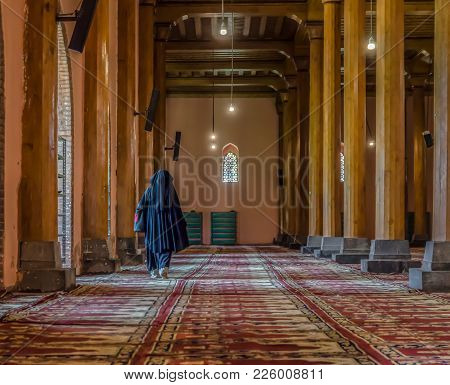 Jamia Masjid Mosque-the Biggest Mosque In Kashmir. Muslim Woman Inside The Jamia Masjid Mosque, Srin