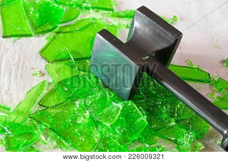 Cracking Broken Glass Candy With A Mallet.