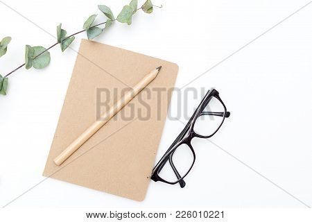 Diary For Notes And Glasses On A White Background. Minimalist Design