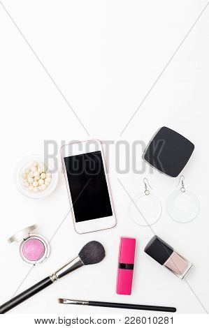 Make Up On White Background And Accessories. Vertical Flat Lay