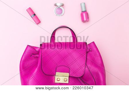 Female Bright Pink Backpack On A Pink Background. Flat Lay