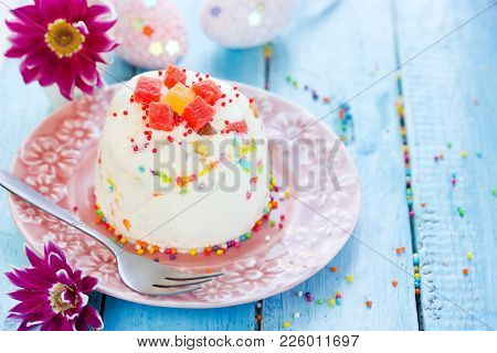 Easter Quark Dessert With Candied Fruit And Colorful Sprinkle