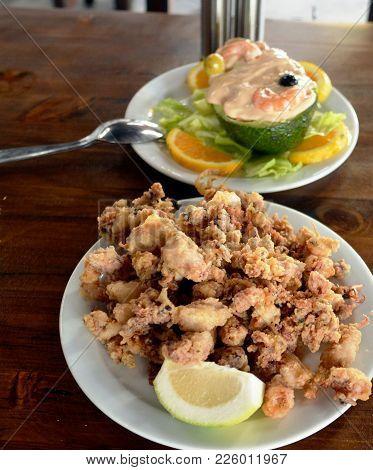 Calamari, Deep Fried Squid With Lemon. Spanish Food.