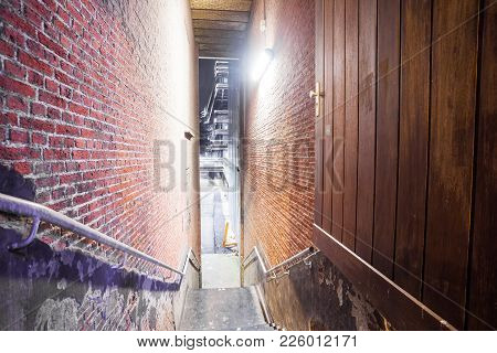 Between Two Large Buildings Is This Beautiful Passage With A Staircase With Handle