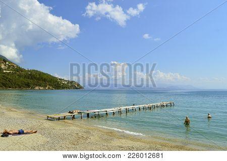 Ipsos, Corfu, Greece - October 2, 2017 : Ipsos Beach Pier In Corfu A Greek Island In The Ionian Sea