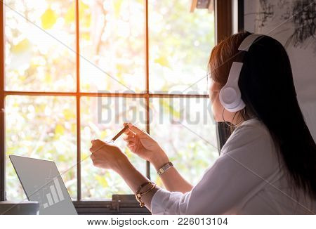 Businesswoman Caucasian Working  Laptop Computer And Listening Music Headphone For Relax Feeling  An