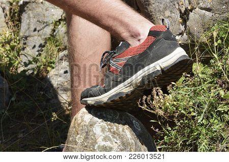 Walking Shoes. All Terrain Shoes. Hiking Shoes On Hiker Outdoors Walking Crossing River Creek. Woman