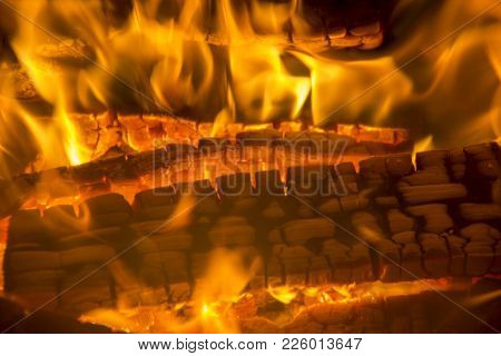 burning firewood coal closeup in the fireplace. Fire fireplace ember wood home Embers closeup. Glowi