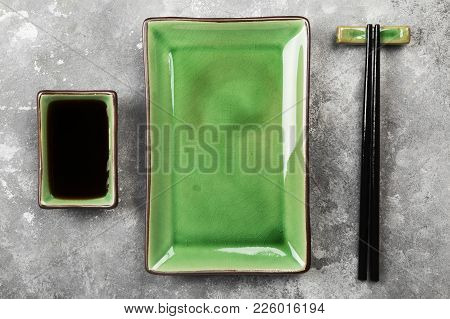 Traditional Ware For Asian Food On A Gray Background. Top View. Food Background