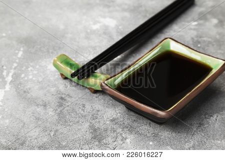 Soy Sauce In Traditional Asian Ware On A Gray Background. Copy Space. Food Background
