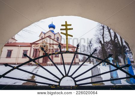 Losinka, Poland - January 26, 2018: Cross On A Gate Of St James The Less Apostle Wooden Orthodox Chu