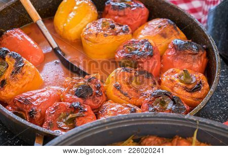 Red And Yellow Bell Peppers Stuffed With Meat