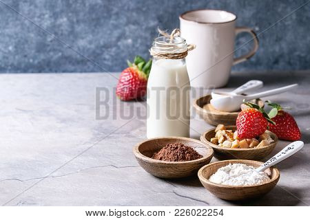 Ingredients For Cooking Chocolate Mug Cakes. Flour, Cocoa Powder, Sugar, Caramel In Wooden Bowls, Mi