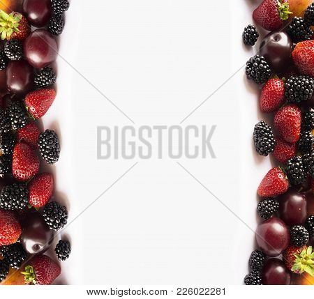 Ripe Blackberries, Strawberries And Plums On White Background. Mix Berries And Fruits On A White. Be