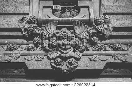 Gothic Gargoyle Facade At Entrance Of Building In Milan, Italy