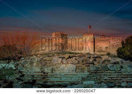Midieval Crusader Castle Flying A Turkish Flag At Sunset