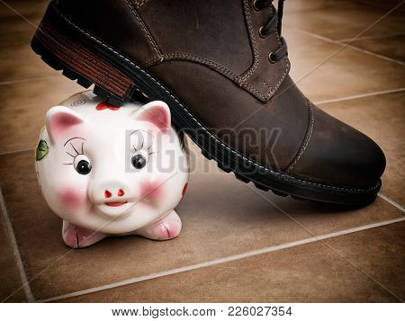 A Shoe Treads Piggy Bank As A Metaphor About Savings Problems.