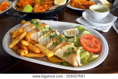 Grilled Calamari, Vegetables And French Fries. Close Up.