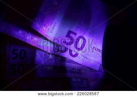 Banknotes In Uv Light.